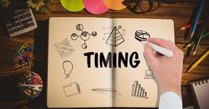 Timing graphic on a notebook. hand drawing it. Digital composite of Timing graphic on a notebook. hand drawing it Royalty Free Stock Images
