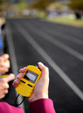 Timing a Race. Stopwatch for running a race around a track with  lines Royalty Free Stock Photography