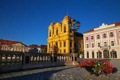 Timisoara, Румыния - квадрат соединения Piata Unirii с католическим куполом Стоковые Изображения RF