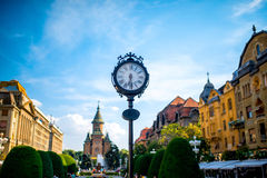 Timisoara. Beautiful vintage clocks on Victory square in Timisoara city on suset, Romania Royalty Free Stock Photography