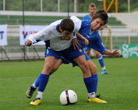 Timisoara - granicar youth soccer game. KAPOSVAR, HUNGARY - JULY 24: Unidentified players in action at the VI. Youth Football Festival Under 14 Final Banatul Stock Image