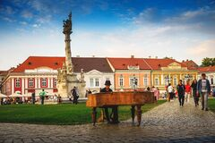 Timisoara old city square after restriction and the famous pianist from the Unirii square