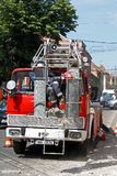 TIMISOARA, ROMANIA –12.04.2011 Firefighter in specific equipment intervenes from high rise ladder stock photo