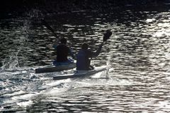 TIMISOARA, ROMANIA – 11.07.2014 Two kayak athletes, sportsmen on the Bega River at training, in sports equipment with stock images