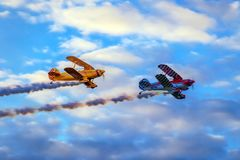 Vintage planes doing demonstrations at one air show. TIMISOARA, ROMANIA - JUNE 23, 2018: Vintage planes doing demonstrations at one air show organized by stock image