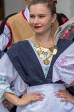 Young serbian dancer girl from Banat, in traditional costumes, s. TIMISOARA, ROMANIA - JUNE 10, 2018: Young serbian dancer girl from Banat, in traditional royalty free stock photography