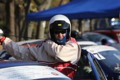 TIMISOARA, ROMANIA –11.11.2018 Racing pilot by putting his protective gear, equipmen stock photo