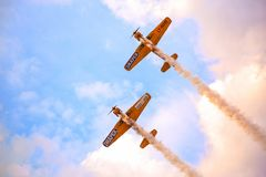 Timisoara, Romania - Yak 52 airplane from the team Iacarii Acrobati performing a demonstration flight at Timisoara Ai. Timisoara, Romania - Yak 52 airplanes from Royalty Free Stock Photo