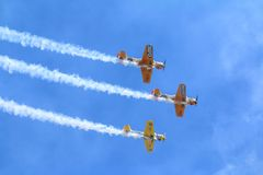Timisoara, Romania - Yak 52 airplane from the team Iacarii Acrobati performing a demonstration flight at Timisoara Ai. Timisoara, Romania - Yak 52 airplanes from Royalty Free Stock Photos