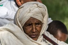 Timkat celebration in Ethiopia. Gonder, Ethiopia - January 20, 2012: Portrait of old woman with traditional headscarf in the street of Gonder during the Timkat Royalty Free Stock Photo