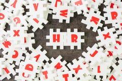 Timme, personalresursbegrepp, vit pusselfigursåg med alfabetet som bygger ordet timme på mitten, jobb och karriärrekrytering royaltyfria bilder