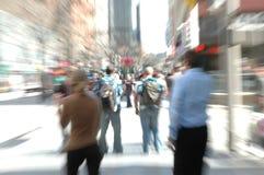 timmefolket rusar Fotografering för Bildbyråer