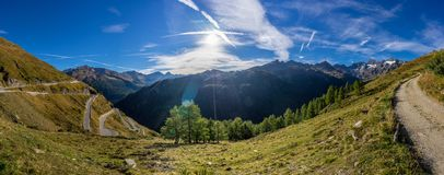 Mountains, peaks and trees landscape, natural environment. Timmelsjoch High Alpine Road. Timmelsjoch High Alpine Road landscape panorama. Mountains and peaks royalty free stock photography