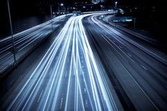 timmen rusar trafik Arkivbild
