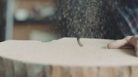 Timmerman Cutting Wood With Handsaw in Workshop stock footage