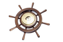 Timón de madera con el barómetro Foto de archivo