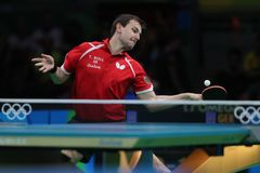 Timo Boll playing table tennis at the Olympic Games in Rio 2016. Timo Boll from Germany at the Olympic Games in Rio 2016 Royalty Free Stock Photos