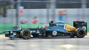 Timo Glock som är tävlings- i GP för F1 Singapore Royaltyfria Bilder