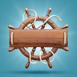 Timone di legno con una plancia di legno in bianco Immagine Stock