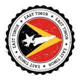 timor flaga w rocznik pieczątce i mapa Obrazy Royalty Free