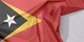 Timor Leste tkaniny flaga zagniecenie z biel przestrzenią i krepa obrazy stock