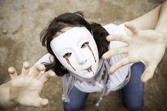 Timore dell'uccisore della ragazza immagini stock libere da diritti