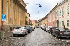 Timotei Popovich street in a rainy day in Sibiu city in Romania. Sibiu, Romania, October 07, 2017 : Timotei Popovich street in a rainy day in Sibiu city in Royalty Free Stock Photo