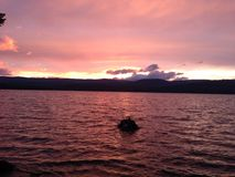 Timothy Lake Sunset. Pink sunset and clouds at sunset over Timothy Stock Photos