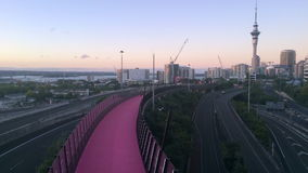 Timplapse of bright pink cycleway and Auckland skyline. The cycleway inner city cycling and pedestrians network is New Zealand's biggest urban cycling stock video footage
