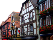 timrade half hus för alsace facades Arkivbilder