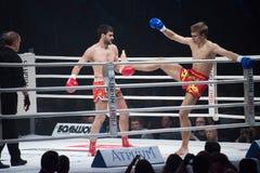 Timur Aylyarov hold Alexander Mischenko by leg Royalty Free Stock Image