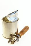 Tin banks and can opener Stock Images