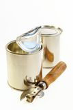 Tin banks and can opener Stock Image