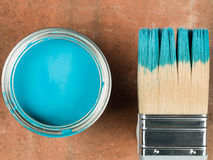 Tin of Blue Paint With a Paint Brush Stock Photography