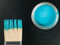Tin of Blue Paint With a Paint Brush Stock Photo