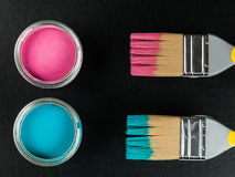 Tin of Blue and Pink Paint with Paint Brushes Stock Images