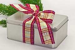 Tin box tied with ribbon. Royalty Free Stock Images