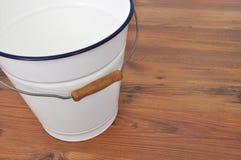 Tin bucket on wood Royalty Free Stock Image