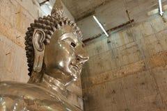 A tin buddha. In temple at Ranong, Thailand stock photos