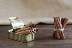 Tin can with cinnamon sticks Stock Photo