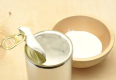 Tin can with coconut milk Royalty Free Stock Photography