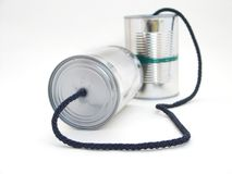 Tin can commication. Two tins with string stock photos