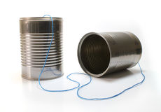Tin Can Communication. Tin can telephone with blue thread Royalty Free Stock Image