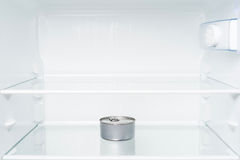 Tin can in empty refrigerator. Royalty Free Stock Image