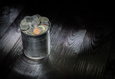 Tin can with full of coin Stock Photography