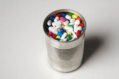Tin can full of pills Stock Images