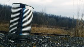 Tin Can on Gravel Surface Stock Photo