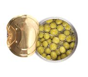 Tin can with green peas. Royalty Free Stock Photo