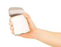 Tin can in hand Royalty Free Stock Photo