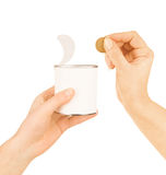 Tin can in hand Stock Images